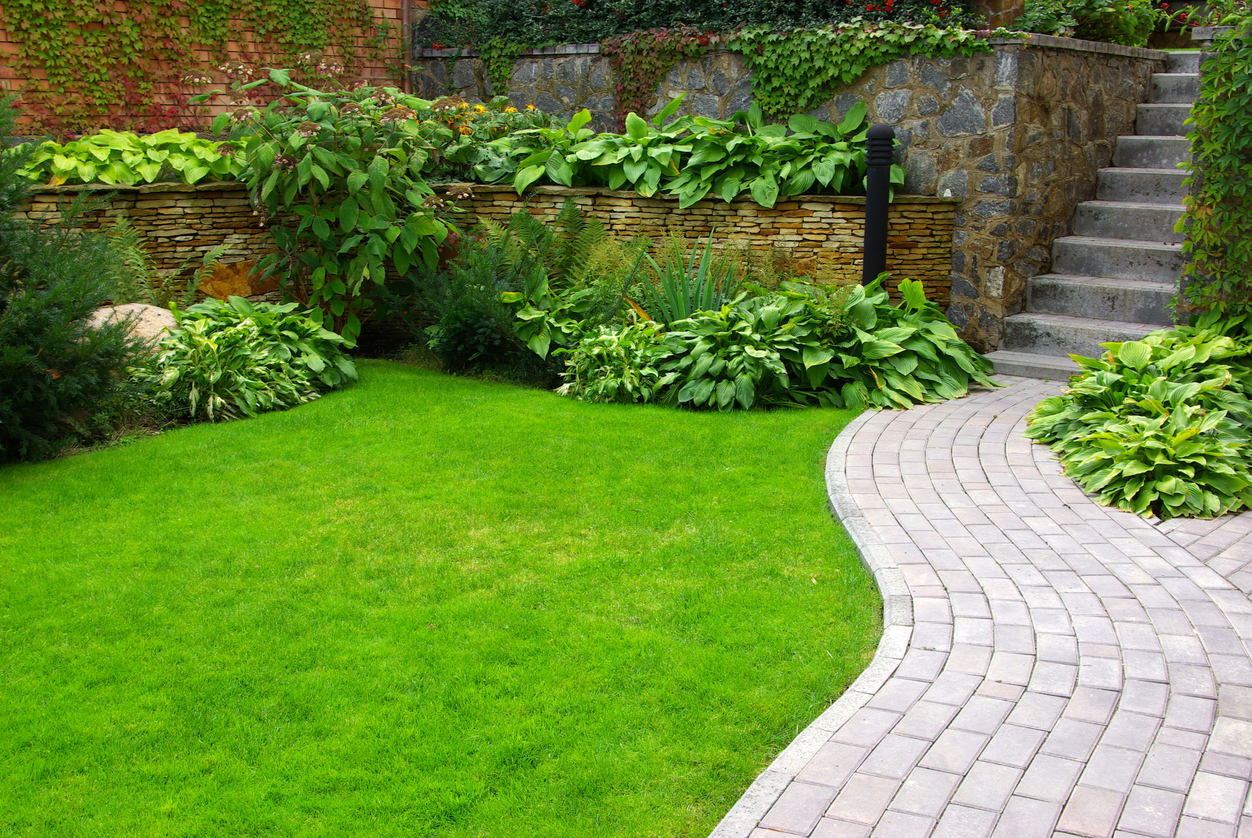 garden stone path with grass growing up between the stones - Garden Design Trends 2017